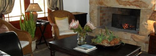 Cosy fireplace to warm chilly winter evenings at the Draaihoek Restaurant.